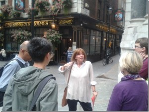 Sue guiding before the Sherlock Holmes pub