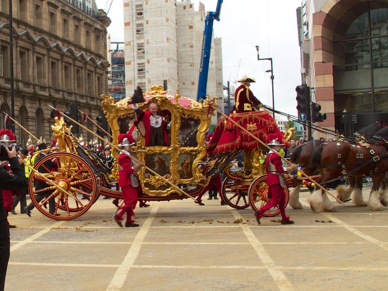 A wave from the Lord Mayor as he takes his place at the end of the procession and makes his way to St. Paul's Cathedral for a blessing from the Dean and onwards to the Royal Courts of Justice.