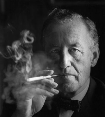 """Ian Fleming, headshot"" by Source (WP:NFCC#4). Licensed under Fair use via Wikipedia - https://en.wikipedia.org/wiki/File:Ian_Fleming,_headshot.jpg#/media/File:Ian_Fleming,_headshot.jpg"